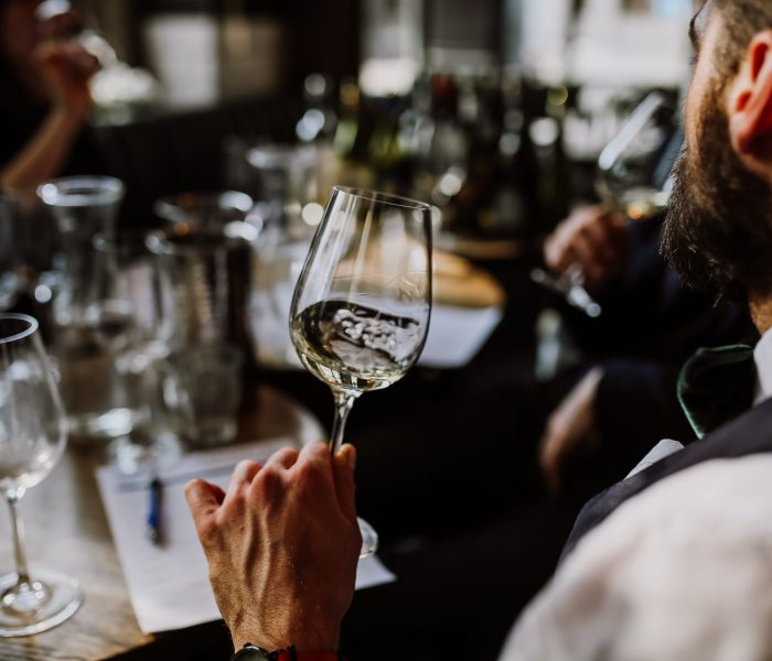 A,Young,European,Man,Drinking,White,Wine,At,The,Wine